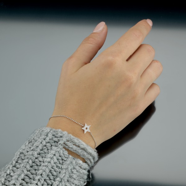 Zartes Armband mit Brillantstern in 750/000 Weißgold der Linie Evaine Swing